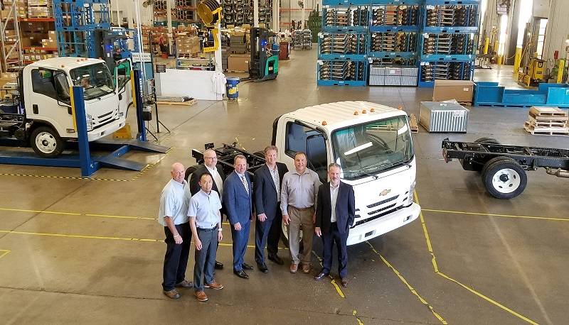 Spartan motors hosts general motors and isuzu executives as first chevrolet medium duty truck General motors medium duty trucks