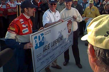 Luyendyk with  $100,000 PPG Pole Prize